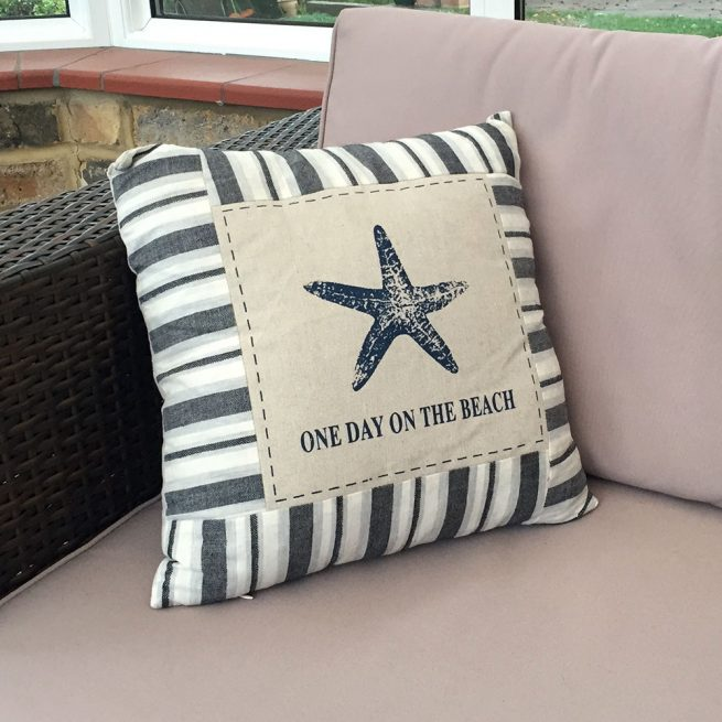 One day on the beach starfish cushion